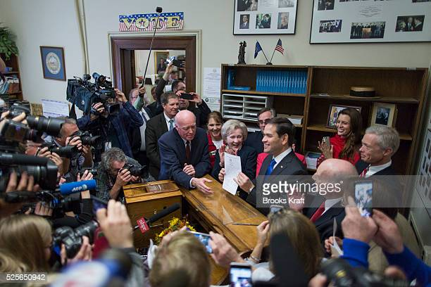 Republican presidential candidate Marco Rubio files his papers for the New Hampshire primary ballot at the State House in Concord