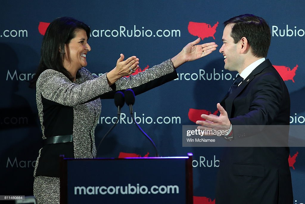 Republican presidential candidate Marco Rubio (R) is greeted by South Carolina Gov. Nikki Haley (L) before addressing ssupporters at a primary night event February 20, 2016 in Columbia, South Carolina. Rubio was locked in a tight race with Sen. Ted Cruz for second place in the ÒFirst in the SouthÓ primary.