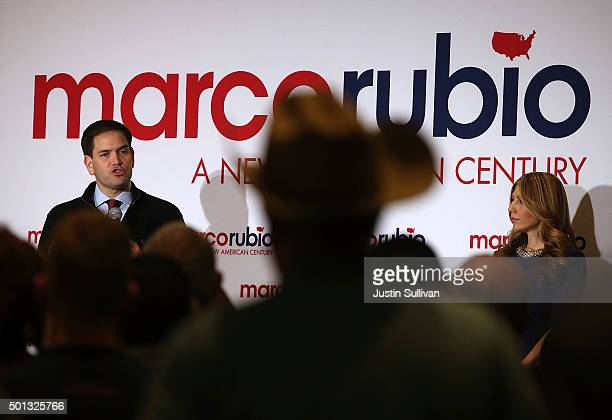 Republican presidential candidate Marco Rubio speaks during a campaign rally as his wife his wife Jeanette Dousdebes looks on at the Renaissance Las...