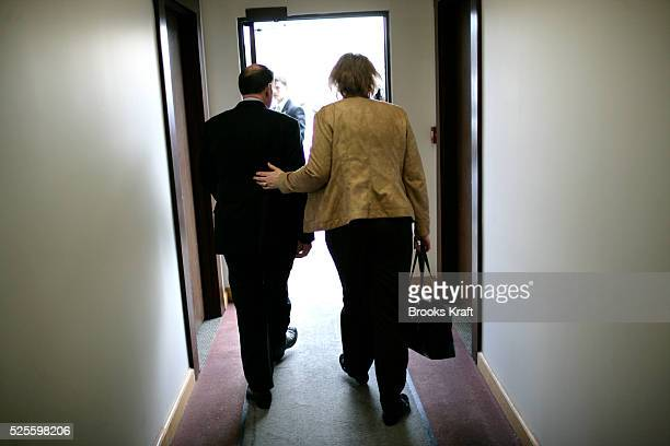 Republican presidential candidate Mike Huckabee and his wife Janet depart his campaign headquarters in Concord.