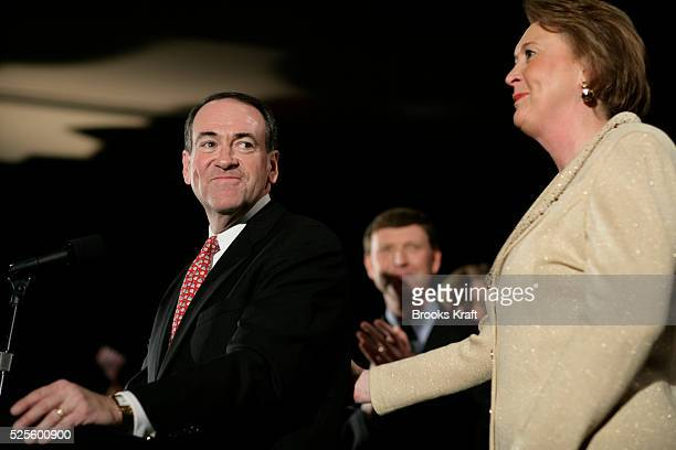 Republican presidential candidate Mike Huckabee and his wife Janet addresses supporters in Des Moines after his victory in the Iowa Caucus.