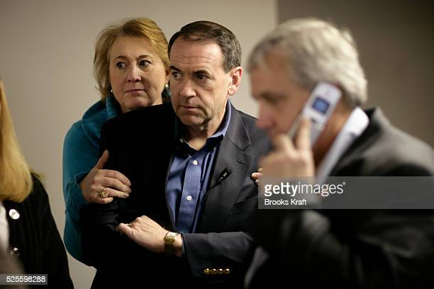 Republican presidential candidate Mike Huckabee in a holding room with his wife Janet between events in Littleton.