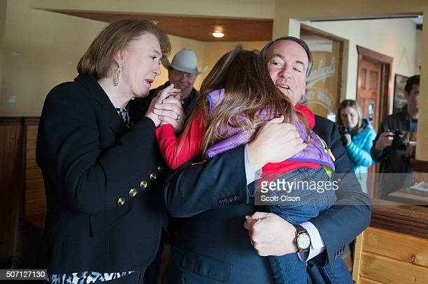 Republican presidential candidate Mike Huckabee is greeted by his wife Janet and granddaughter Scarlett as he arrives for a campaign stop at Jeff's...