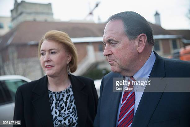 Republican presidential candidate Mike Huckabee is greeted by his wife Janet as he arrives for a campaign stop at Jeff's Pizza on January 27 2016 in...