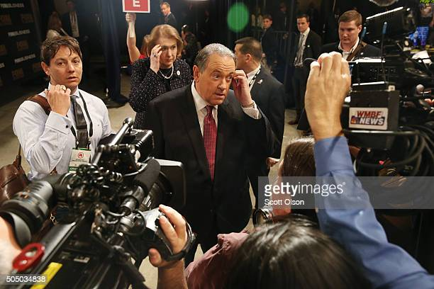 Republican presidential candidate Mike Huckabee talks to reporters in the spin room after the first part of the Fox Business Network Republican...