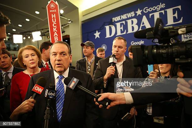 Republican Presidential candidate Mike Huckabee visits the spin room after his Republican Presidential debate sponsored by Fox News and Google at the...