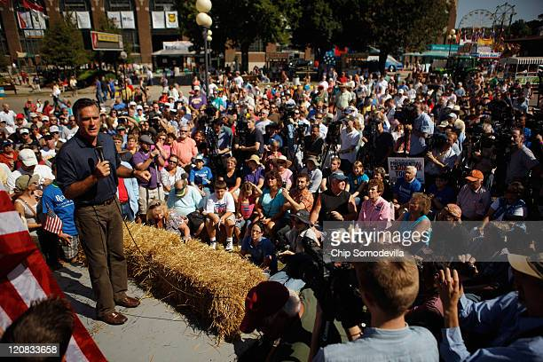 Republican presidential candidate Mitt Romney addresses a large audience during his time on the Des Moines Register's Soapbox at the Iowa State Fair...