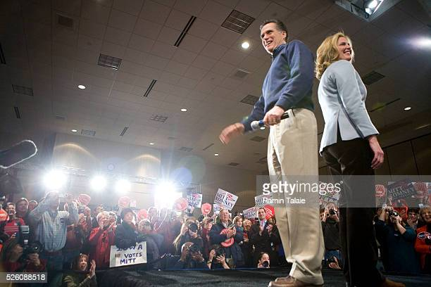 Republican presidential candidate Mitt Romney and his wife Ann appear on stage during a campaign rally in West Des Moines.
