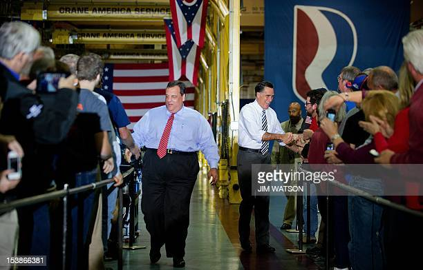 US Republican presidential candidate Mitt Romney and New Jersey Governor Chris Christie shakes hands with employees and their family members as they...