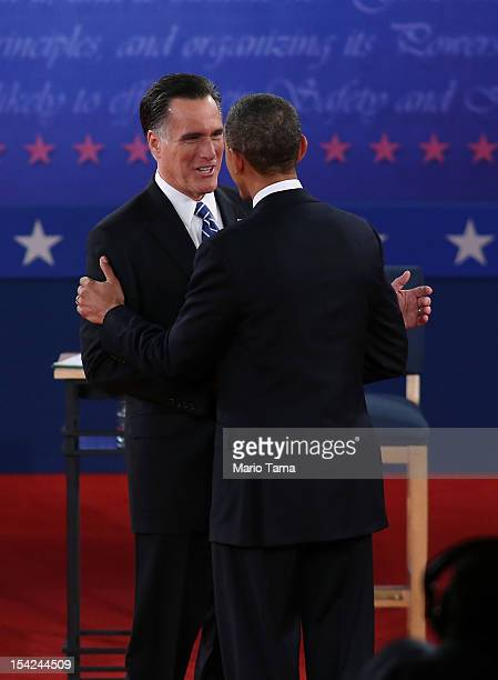Republican presidential candidate Mitt Romney and US President Barack Obama greet each other at the beginning of a town hall style debate at Hofstra...