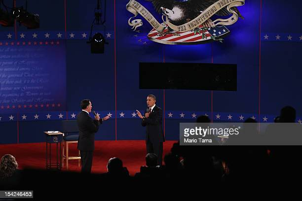 Republican presidential candidate Mitt Romney and US President Barack Obama respond to questions during a town hall style debate at Hofstra...