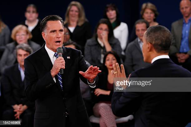Republican presidential candidate Mitt Romney and US President Barack Obama speak during a town hall style debate at Hofstra University October 16...