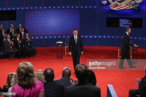 Republican presidential candidate Mitt Romney and US President Barack Obama appear on stage after the town hall style debate at Hofstra University...
