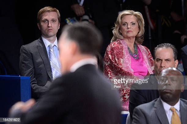 Republican presidential candidate Mitt Romney answers a question as son Ben Romney and wife Ann Romney look on from the audience during a town hall...