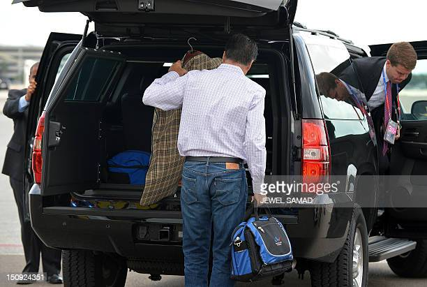 US Republican presidential candidate Mitt Romney arrives to board his campaign plane at Tampa International Airport in Tampa Florida on August 29...
