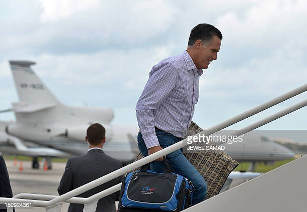 US Republican presidential candidate Mitt Romney boards his campaign plane at Tampa International Airport in Tampa Florida on August 29 2012 en route...