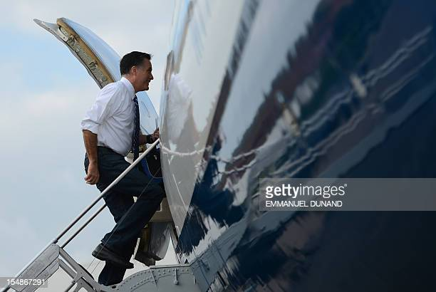 US Republican Presidential candidate Mitt Romney boards his plane at Tampa International Airport in Tampa Florida October 28 2012 AFP PHOTO/Emmanuel...
