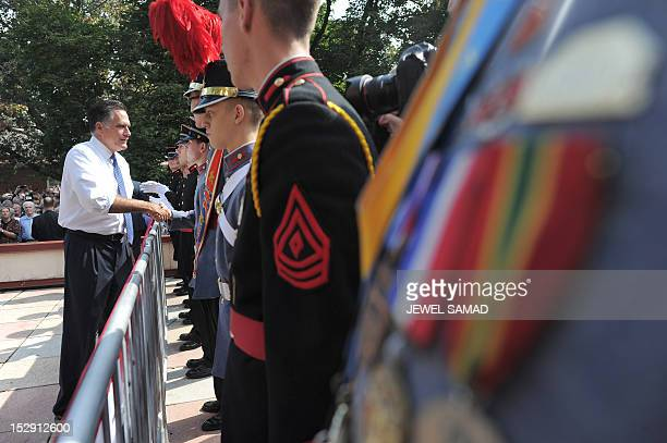 US Republican presidential candidate Mitt Romney greets cadets during a campaign rally at the Valley Forge Military Academy and College in Wayne...