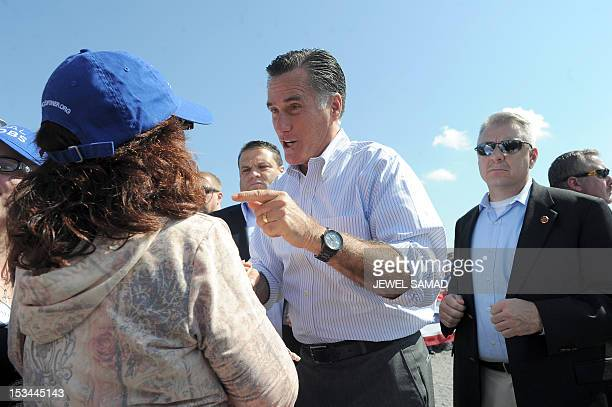 US Republican presidential candidate Mitt Romney greets supporters during a campaign event on October 5 2012 in Abingdon Virginia Fresh from a...