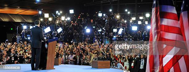 Republican presidential candidate Mitt Romney greets supporters as he concedes the presidency during his campaign election night event at the Boston...