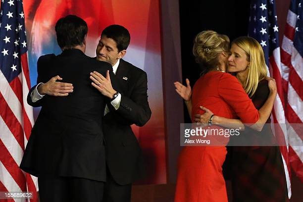 Republican presidential candidate Mitt Romney hugs Republican vice presidential candidate US Rep Paul Ryan while his wife Ann Romney hugs Janna Ryan...