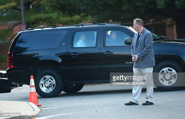 US Republican presidential candidate Mitt Romney is driven by motorcade out of a hotel after spending his day in debate preparation in Burlington...