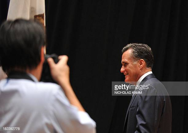 Republican presidential candidate Mitt Romney leaves after speaking to the press in Costa Mesa, California, on September 17, 2012. AFP PHOTO/Nicholas...