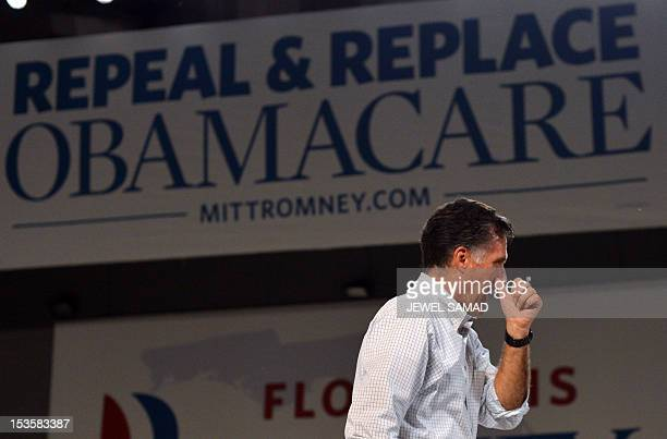 US Republican presidential candidate Mitt Romney leaves after speaking at a campaign rally on October 6 2012 in Apopka Florida A relieved US...