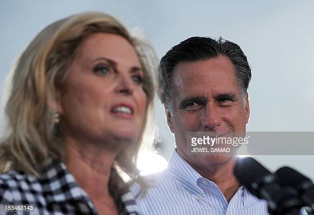 US Republican presidential candidate Mitt Romney looks on as his wife Ann speaks during a campaign event on October 5 2012 in St Petersburg Florida...