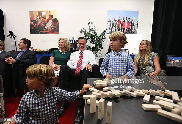 Republican presidential candidate Mitt Romney sits backstage with his wife Ann Romney and family members before the start of a debate with US...