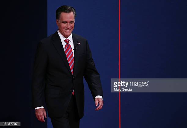 Republican presidential candidate Mitt Romney takes the stage for the debate with US President Barack Obama at the Keith C and Elaine Johnson Wold...