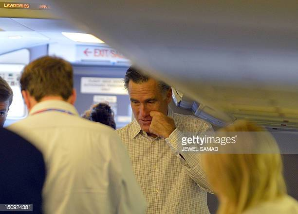 US Republican presidential candidate Mitt Romney talks to his staffs on board his campaign plane at Tampa International Airport in Tampa Florida on...