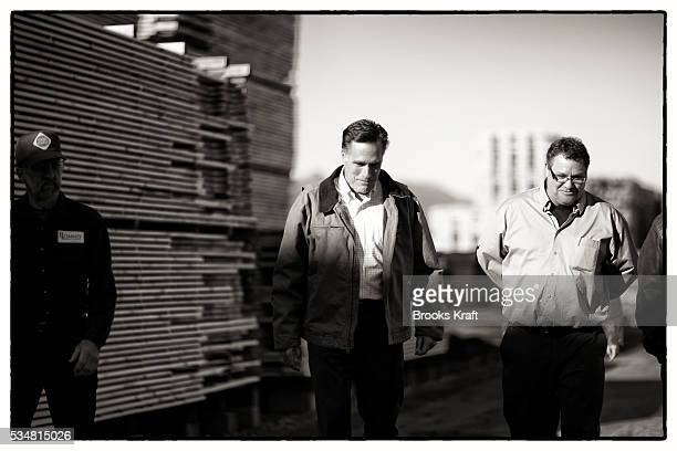 Republican presidential candidate Mitt Romney visits Madison Lumber Mill during a campaign trip in New Hampshire