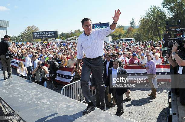 US Republican presidential candidate Mitt Romney waves during a campaign event on October 5 2012 in Abingdon Virginia Fresh from a muchneeded debate...