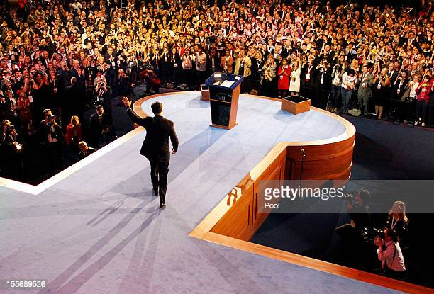 Republican presidential candidate Mitt Romney waves to supporters at the podium as he concedes the presidency during Mitt Romney's campaign election...