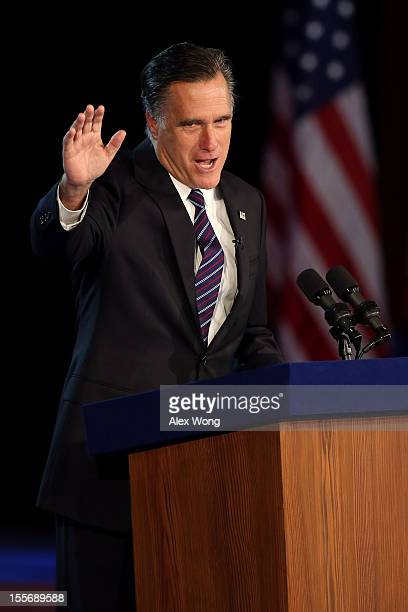 Republican presidential candidate Mitt Romney waves to the crowd while speaking at the podium as he concedes the presidency during Mitt Romney's...