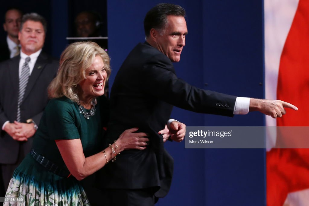 Republican presidential candidate Mitt Romney with wife, Ann Romney greet people on stage after the debate at the Keith C. and Elaine Johnson Wold Performing Arts Center at Lynn University on October 22, 2012 in Boca Raton, Florida. The focus for the final presidential debate before Election Day on November 6 is foreign policy.