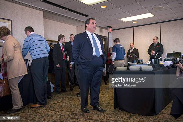 Republican presidential candidate New Jersey Gov Chris Christie arrives at the Bull Moose Club February 1 2016 in downtown Des Moines Iowa to speak...