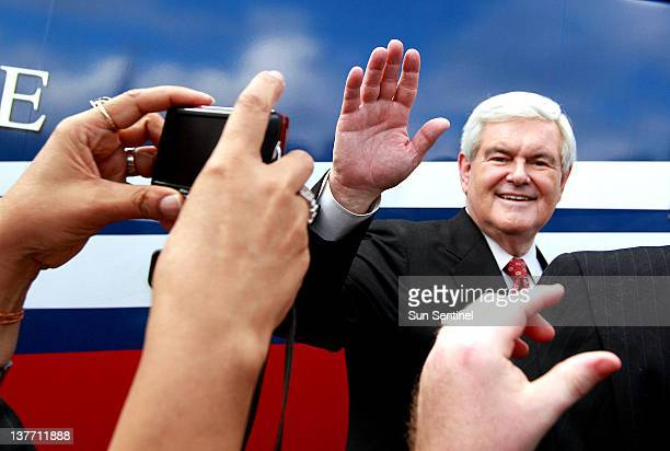 Republican presidential candidate Newt Gingrich greets supporters during a rally at Wings Plus in Coral Springs, Florida, Wednesday, January 25, 2012.