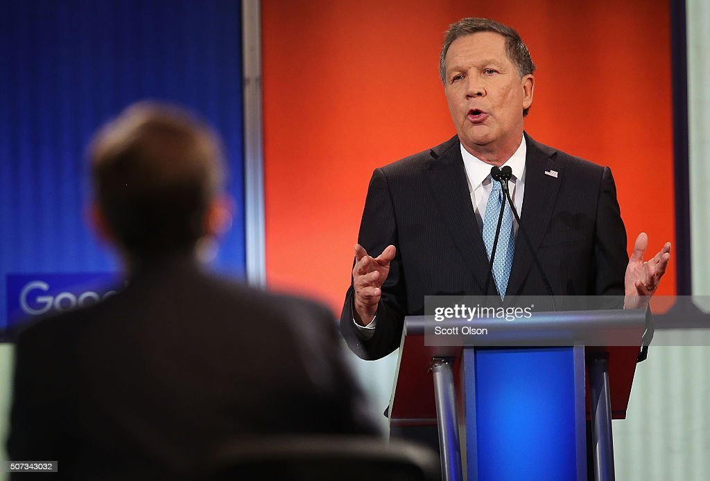 Republican presidential candidate Ohio Governor John Kasich participates in the Fox News - Google GOP Debate January 28, 2016 at the Iowa Events Center in Des Moines, Iowa. Residents of Iowa will vote for the Republican nominee at the caucuses on February 1. Donald Trump, who is leading most polls in the state, decided not to participate in the debate.