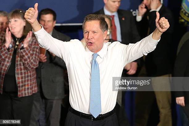 Republican presidential candidate Ohio Governor John Kasich waves to the crowd after speaking at a campaign gathering with supporters upon placing...
