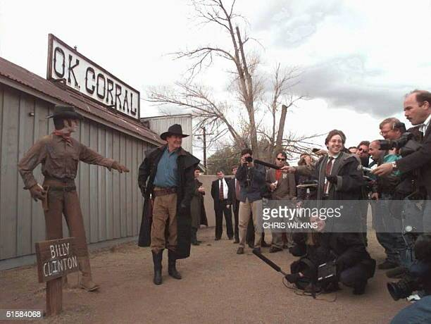Republican presidential candidate Pat Buchanan poses for photos 26 February during a stop at the O.K. Corral in Tombstone, Arizona. Buchanan is...