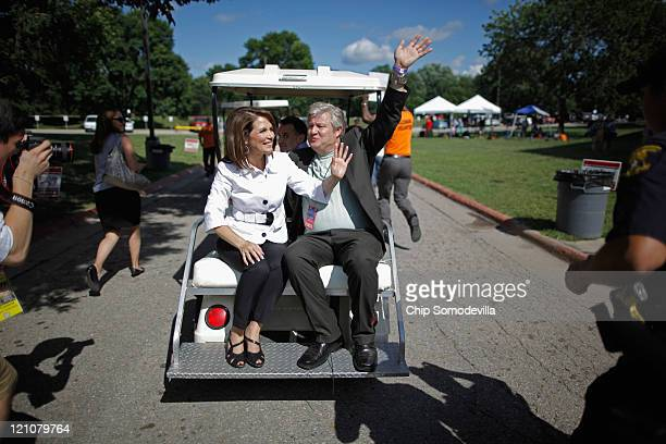 Republican presidential candidate Rep Michele Bachmann and her husband Marcus Bachmann race away from the the Hilton Coliseum on a golf cart at Iowa...