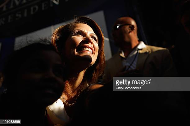 Republican presidential candidate Rep Michele Bachmann poses for photographs with her supporters after winning the Iowa Straw Poll outside the Hilton...