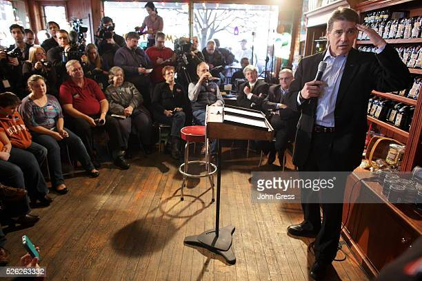 Republican presidential candidate Rick Perry campaigns at the Smokey Row Coffee Shop in Pella Iowa December 28 2011