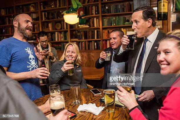 Republican presidential candidate Rick Santorum drinks a beer with members of the Dallas County GOP at Mickey's Irish Pub on January 28 2016 in...