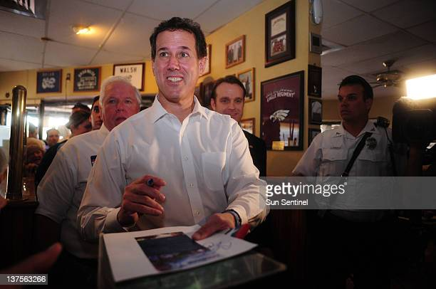 Republican presidential candidate Rick Santorum greets supporters at the Wing Stop in Coral Springs, Florida, Sunday, January 22, 2012.