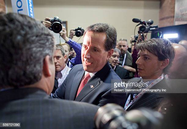 Republican presidential candidate Rick Santorum is surrounded by reporters as he visits the spin room after the CNN debate in North Charleston on...