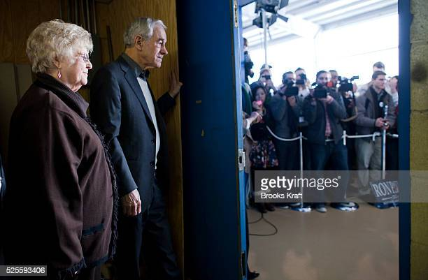 Republican presidential candidate Ron Paul waits backstage with his wife Carol before a rally in Nashua New Hampshire