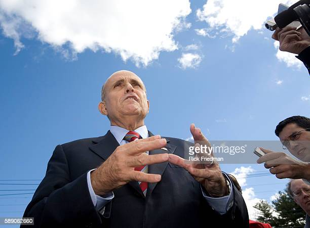 Republican presidential candidate Rudy Giuliani speaks with the media after campaigning at the Golden Egg Restaurant in Portsmouth